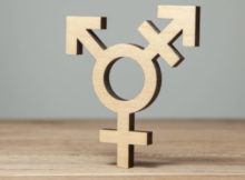 Symbol of transgender from tree on wooden table.