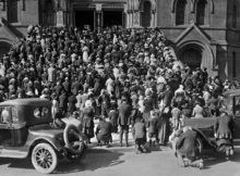 The congregation praying on the steps of the Cathedral of Saint Mary of the Assumption, where they gathered to hear mass and pray during the influenza epidemic, San Francisco, California.